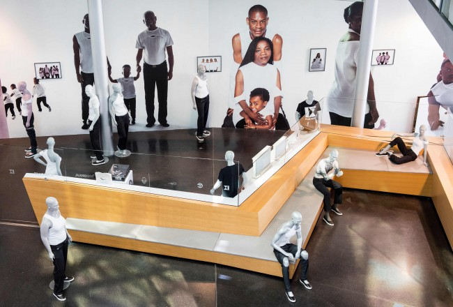 TELFAR: RETROSPECTIVE, 2016, Installation view,Installation at the Akademie der Künste and at KW Institute for Contemporary Art TELFAR Family portrait, Photo Series Asger Carlsen,TELFAR Formes Mannequin portrait head of TELFAR Frank Benson, Courtesy Frank Benson, Asger Carlsen, TELFAR: PERSONAL UNIFORMS, 2016, Guard and visitor uniforms for the 9th Berlin Biennale for Contemporary Art, Photo: Timo Ohler