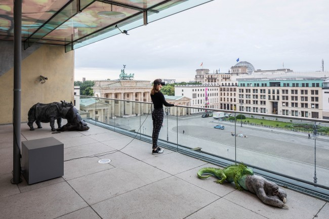 Jon Rafman: Installation view, Photo: Timo Ohler. From left to right: L'Avalée des avalés (The Swallower Swallowed) Rhino/Bear, 2016, High-density polyurethane, acrylic Courtesy Jon Rafman; Future Gallery, Berlin. / View of Pariser Platz, 2016, Marble, virtual reality: Co-Directed by Jon Rafman and Samuel Walker, Courtesy Jon Rafman; Future Gallery, Berlin
